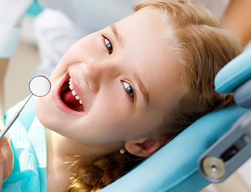Girl in dental chair - Pediatric Dentist in Fargo, ND